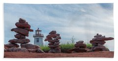 North Cape Lighthouse Behind Stone Cairns Bath Towel