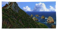Nugget Point Lighthouse Hand Towel by Anthony Dezenzio