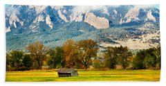 old shed against Flatirons Hand Towel