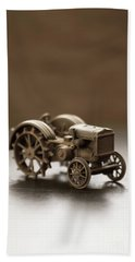 Bath Towel featuring the photograph Old Toy Tractor by Edward Fielding