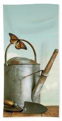 Old Watering Can With A Butterfly Bath Towel