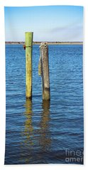Bath Towel featuring the photograph Old Wood Pilings In Blue Water by Colleen Kammerer