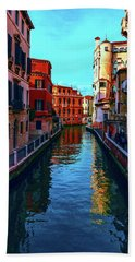 one of the many beautiful old Venetian canals on a Sunny summer day Hand Towel