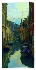 one of the many Venetian canals at the end of a Sunny summer day Hand Towel