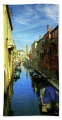one of the many Venetian canals on a Sunny summer day Hand Towel