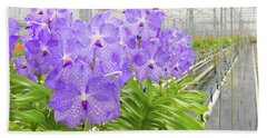 Orchids In A Greenhouse Bath Towel
