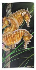 Hand Towel featuring the painting Pacific Lined Seahorse Trio by Phyllis Beiser