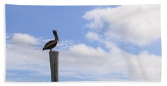 Pelican In The Clouds Bath Towel by Christopher L Thomley