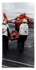 Personnel Carry An Injured Sailor Bath Towel