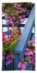 Bath Towel featuring the photograph Petunias On Blue Porch by Elena Elisseeva