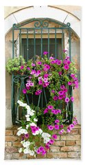 Hand Towel featuring the photograph Petunias Through Wrought Iron by Donna Corless