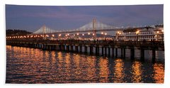 Pier 7 And Bay Bridge Lights At Sunset Hand Towel