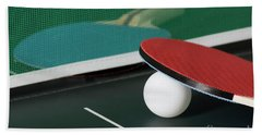 Ping Pong Paddles On Table With Net Bath Towel
