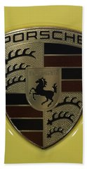 Porsche Emblem On Racing Yellow Bath Towel by Sebastian Musial