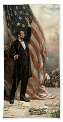 Hand Towel featuring the photograph President Abraham Lincoln - American Flag by International  Images