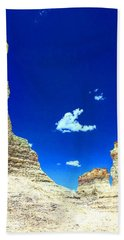 Pristine Sky Meets Historic Rocks Bath Towel