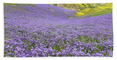 Bath Towel featuring the photograph Purple  Covered Hillside by Marc Crumpler