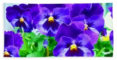 Bath Towel featuring the photograph Purple Pansies by Wendy McKennon