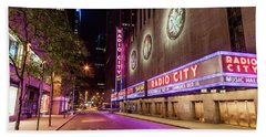 Radio City Music Hall At Night Bath Towel by John McGraw