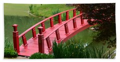 Red Garden Bridge Hand Towel by Kathleen Stephens
