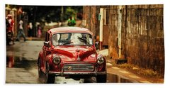 Bath Towel featuring the photograph Red Retromobile. Morris Minor by Jenny Rainbow