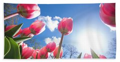 Red Tulips Against Blue Sky Bath Towel by Hans Engbers