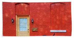 Red Wall White Bike Hand Towel by Edward Fielding