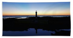 Reflection Of Bodie Light At Sunset Hand Towel
