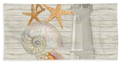Refreshing Shores - Lighthouse Starfish Nautilus N Conch Over Driftwood Background Bath Towel