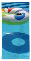 Ring In A Swimming Pool Bath Towel by Michael Canning
