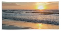 Rising Sun Reflecting On Wet Sand With Calm Ocean Waves In The B Hand Towel