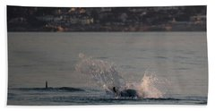 Risso's Dolphins At Play Hand Towel by Suzanne Luft