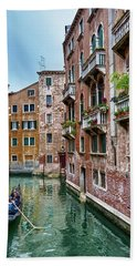 Gondola Ride Surrounded By Vintage Buildings In Venice, Italy Hand Towel