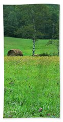 Bath Towel featuring the photograph Round Bale And Wildflowers by Joy Nichols