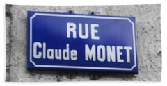 Hand Towel featuring the photograph Rue Claude Monet by Therese Alcorn