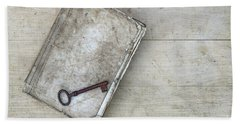 Bath Towel featuring the photograph Rusty Key On The Old Tattered Book by Michal Boubin