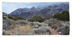 Sandia Mountains Storm Winter Landscape Hand Towel by Andrea Hazel Ihlefeld