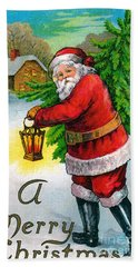 Santa Carrying A Christmas Tree Hand Towel