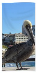 Single Pelican On The Pier Hand Towel by Bonnie Muir