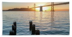 Six Pillars Sticking Out The Water With Bay Bridge In The Backgr Hand Towel