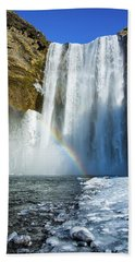 Skogafoss Waterfall Iceland In Winter Bath Towel by Matthias Hauser