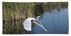Snowy Egret Flying Over Blue Lake Hand Towel