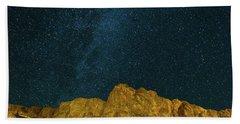 Starry Night Sky Over Rocky Landscape Hand Towel