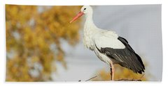 Bath Towel featuring the photograph Stork On A Nest, Trees In The Background by Nick Biemans