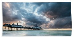 Stormy Sunrise Over Eastbourne Pier Hand Towel