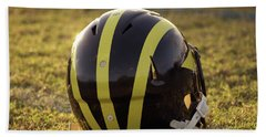 Striped Wolverine Helmet On The Field At Dawn Hand Towel