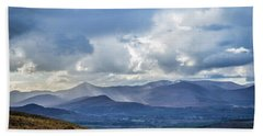 Sun Rays Piercing Through The Clouds Touching The Irish Landscap Bath Towel by Semmick Photo