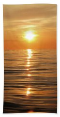 Sun Setting Over Calm Waters Hand Towel