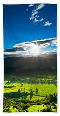 Sunrays Flood Farmland During Sunset Bath Towel