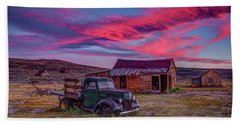 Sunset Over Bodie's Green Truck Bath Towel